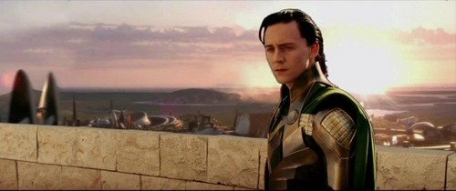 Photoshop wallpaper probably with a well dressed person, an outerwear, and a street titled loki's lfe