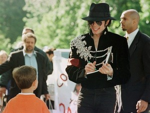Signing An Autograph For A Young fan