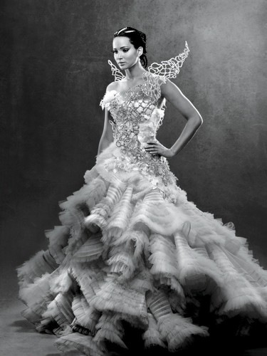 Catching Fire wallpaper probably with a bridesmaid, a gown, and a dinner dress titled Catching Fire
