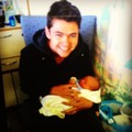 Damian holding his new nephew Noah
