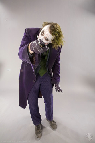 The Joker kertas dinding possibly with an outerwear, a hip boot, and a gasmask called Joker - promo shoot for The Dark Knight