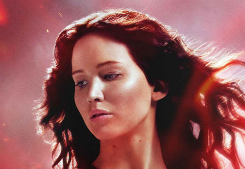 Catching Fire wallpaper possibly containing a portrait entitled Katniss-Catching Fire