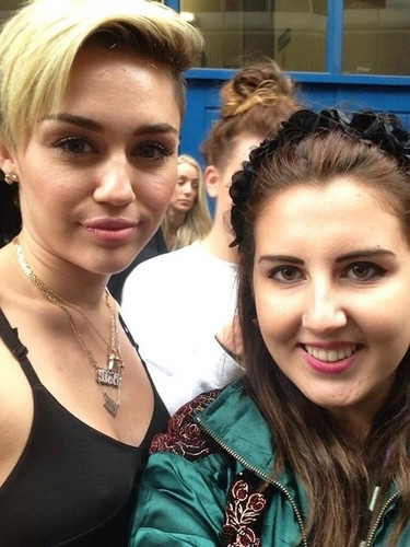 miley cyrus wallpaper containing a portrait entitled Miley with a fan!