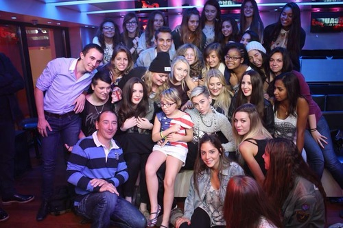 miley cyrus wallpaper probably with a drawing room, a business suit, and a multiplex, multipleks titled Miley with fan in NRJ Radio in Paris
