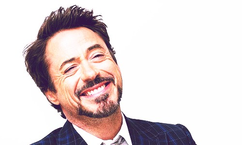 Robert Downey Jr karatasi la kupamba ukuta containing a business suit called best looking man: Downey