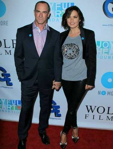 Elliot and Olivia wallpaper containing a business suit, a well dressed person, and a suit entitled Chris & Mariska - Joy Rocks No More 2013