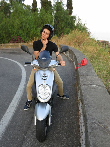 Dylan O'Brien Hintergrund with a motor scooter titled Dylan O'Brien
