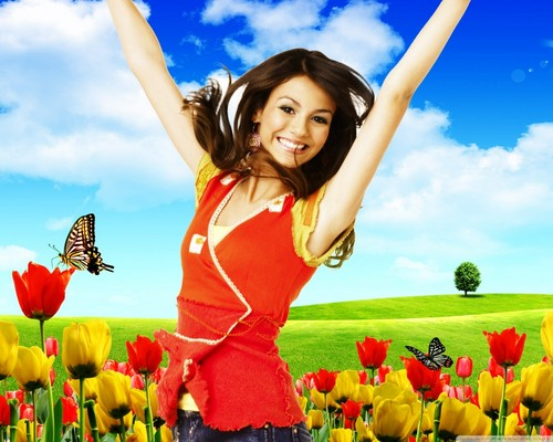 Victoria Justice wallpaper probably with a dinner dress, a cocktail dress, and a bouquet titled Victoria Justice