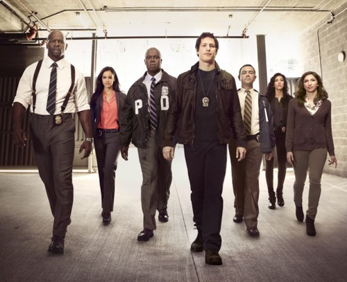 Brooklyn Nine-Nine 바탕화면 with a business suit and a well dressed person titled the cast