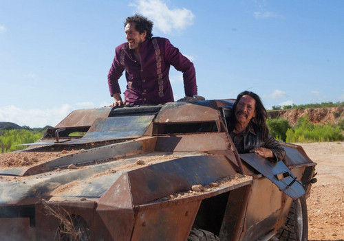 Machete wallpaper probably containing an armored personnel carrier, a personnel carrier, and a tanker entitled Danny Trejo as Machete & Demian Bichir as Mendez