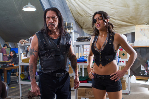 Machete wallpaper possibly containing a hip boot called Danny Trejo as Machete & Michelle Rodriguez as Shé