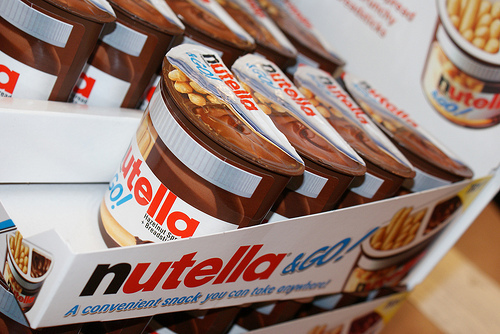 Nutella Hintergrund possibly with a canned food, a canned meat, and a six pack titled Nutella