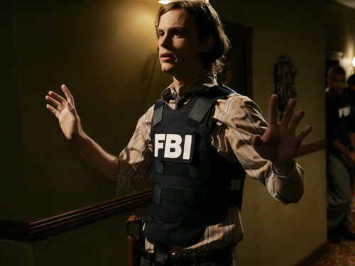 Criminal Minds achtergrond probably containing a bulletproof vest called Spencer Reid