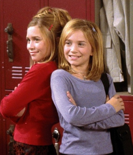 Mary-Kate & Ashley Olsen wallpaper possibly with an outerwear titled mary-kate and ashley