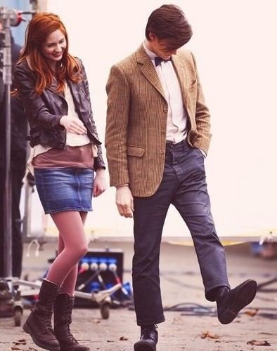 Amy Pond वॉलपेपर with a hip boot, a business suit, and a well dressed person called Amy and The Doctor