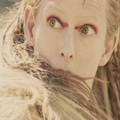 Jadis in the glow from her wand as she turns Oreius to Stone.