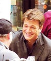 Nathan laughing - nathan-fillion-and-stana-katic photo