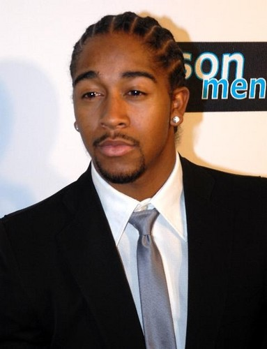 Matty B Raps achtergrond with a business suit and a suit entitled Omarion