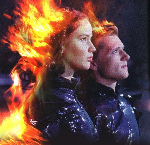 Peeta Mellark and Katniss Everdeen wolpeyper possibly with a apoy and a apoy titled peeta and katniss