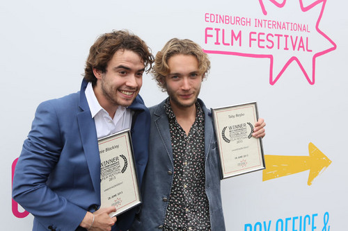 Toby Regbo wolpeyper with a business suit titled Edinburgh International Film Festival '13