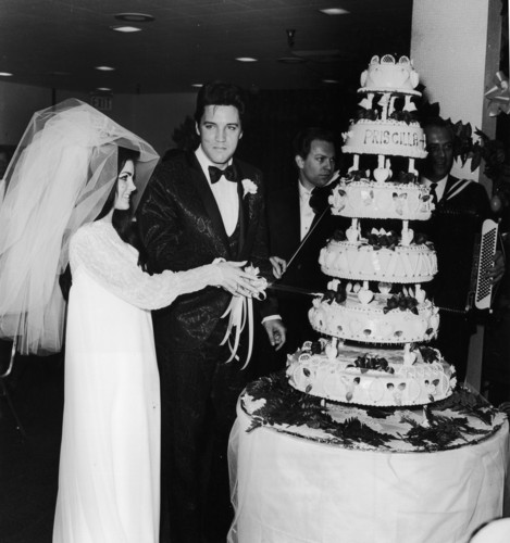 Elvis Presley wallpaper probably with a bouquet, a cupcake, and a tutti frutti called Elvis And Priscilla On Their Wedding Day Back In 1967
