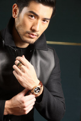 Godfrey Gao achtergrond possibly with a well dressed person, an outerwear, and a box jas entitled Godfrey for BVLGARI