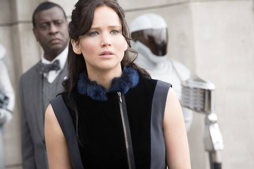 Catching Fire wallpaper probably with an outerwear called Katniss