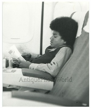 Michael Reading While Traveling