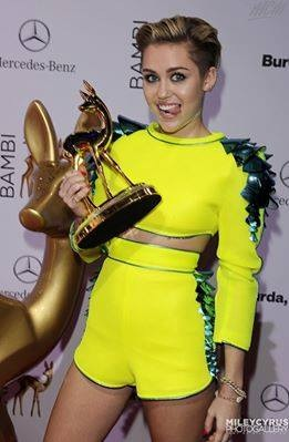Miley Cyrus wallpaper probably with a hip boot titled Miley won Bambi Award 2013