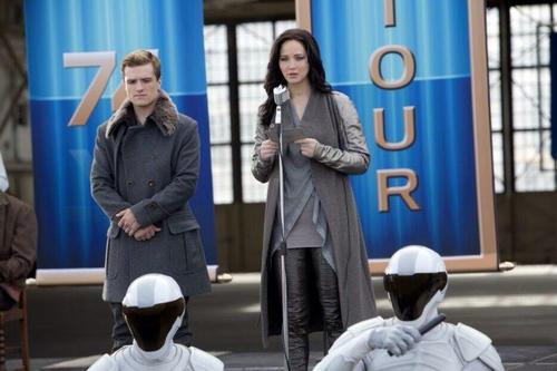 Catching Fire wallpaper with a business suit titled New stills