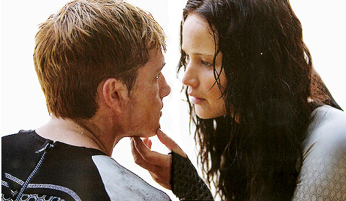 Peeta Mellark and Katniss Everdeen kertas dinding probably with a business suit and a portrait called Peeta & Katniss (Beach scene)
