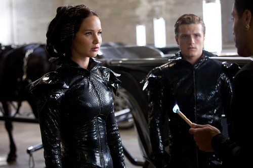 Peeta Mellark and Katniss Everdeen wolpeyper probably containing a hip boot called Peeta and Katniss ♬