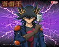 anime - Yusei Fudo holding up a Duel Monster card wallpaper