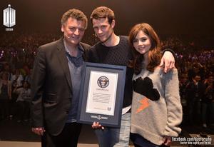 Steven Moffat, Matt Smith and Jenna Coleman accepting the guinness World Record