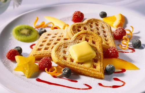 Food wallpaper with a frosted layer cake titled Waffles
