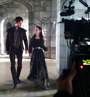 Adelaide Kane and Torrance Cooms on set