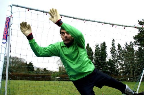 Rowan Atkinson wolpeyper containing a chainlink fence called Keeping Mum