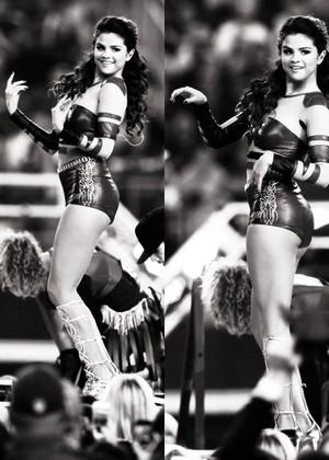 Selena performing at the halftime onyesha at the Cowboys game in Dallas TX (November 28)