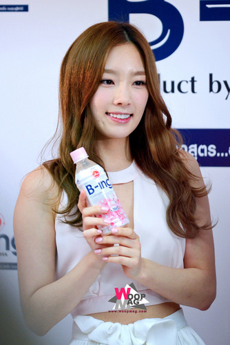 taeyeon (snsd) wallpaper possibly with a bottled water titled Taeyeon B-ing