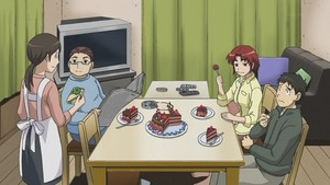 Kosuda and his family eating चॉकलेट cake