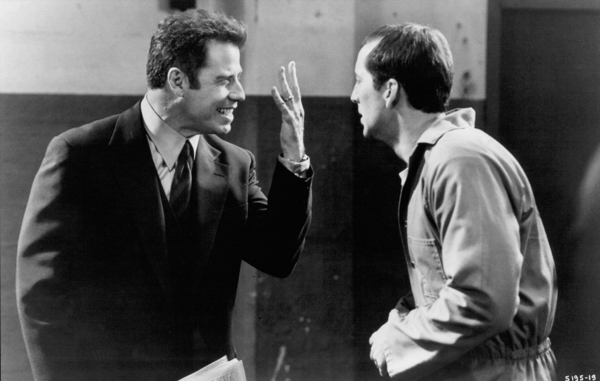Sean Archer (John Travolta) and Castor Troy (Nicolas Cage)