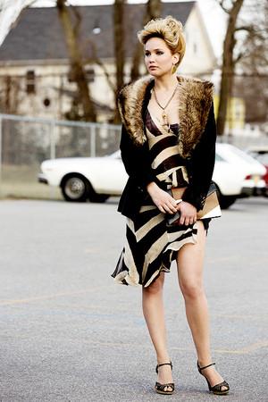Jennifer Lawrence as Rosalyn Rosenfeld in American Hustle