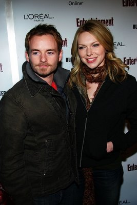 Laura Prepon wallpaper probably containing a workwear titled Christopher Masterson and Laura P.
