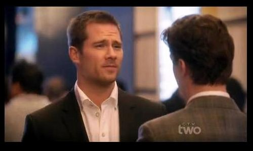 "Luke Macfarlane Hintergrund probably containing a business suit, a suit, and a portrait titled Luke Macfarlane in ""Smash"""