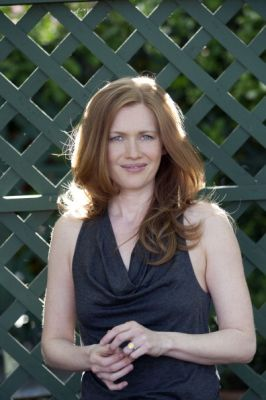 Mireille Enos Hintergrund possibly with a park bench and a portrait titled Mireille Enos