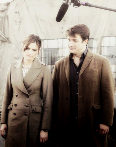 Nathan Fillion & Stana Katic wallpaper possibly with a business suit and a well dressed person titled Stanathan BTS
