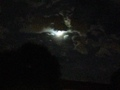 moon emerging from clouds - paganism photo