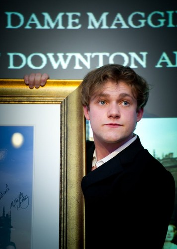 namelessbastard wallpaper containing a business suit, a well dressed person, and a sign titled thomas howes