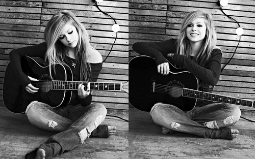 Avril Lavigne wallpaper containing an acoustic guitar and a guitarist entitled Avril Lavigne