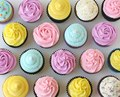 Pink, Purple, Yellow, and White Cupcakes
